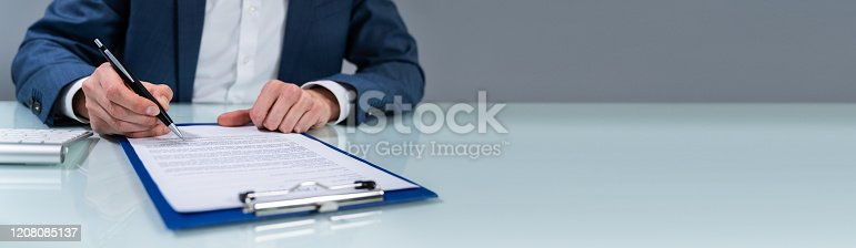 istock Person Signing Contract 1208085137