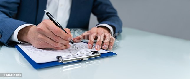istock Person Signing Contract 1208085138