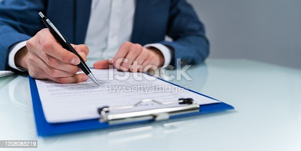istock Person Signing Contract 1208085219