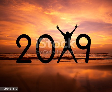 istock Person silhouette jumping in New Year 2019 1059491610