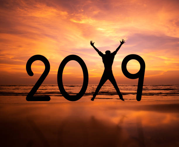 Person silhouette jumping in New Year 2019 stock photo