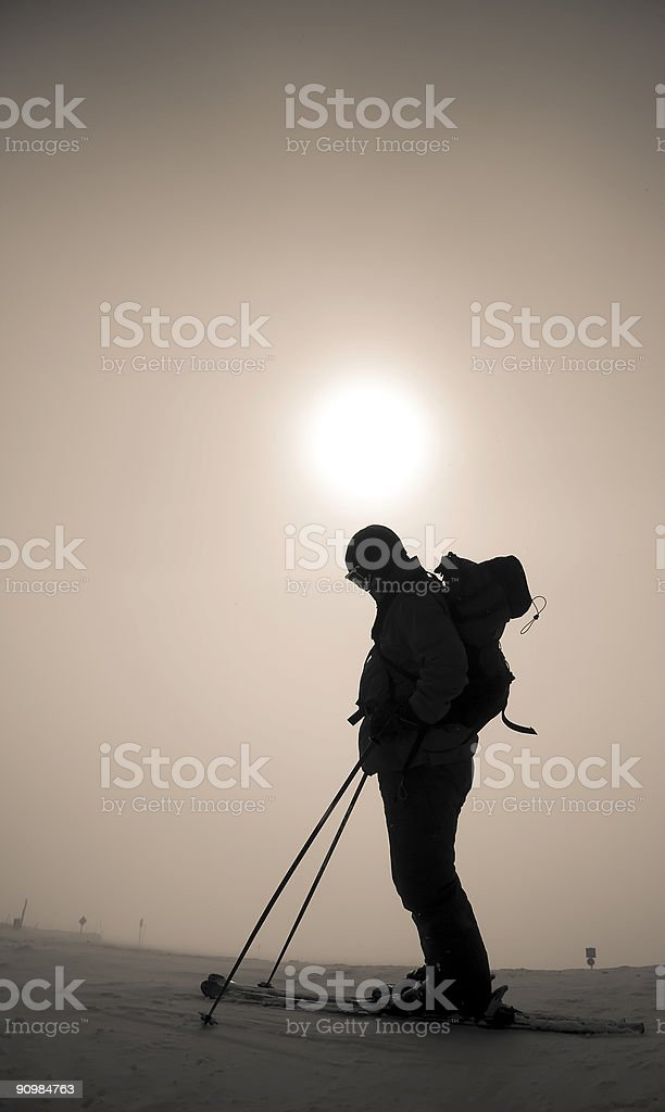 Person Silhouette Skiing in a Whiteout royalty-free stock photo