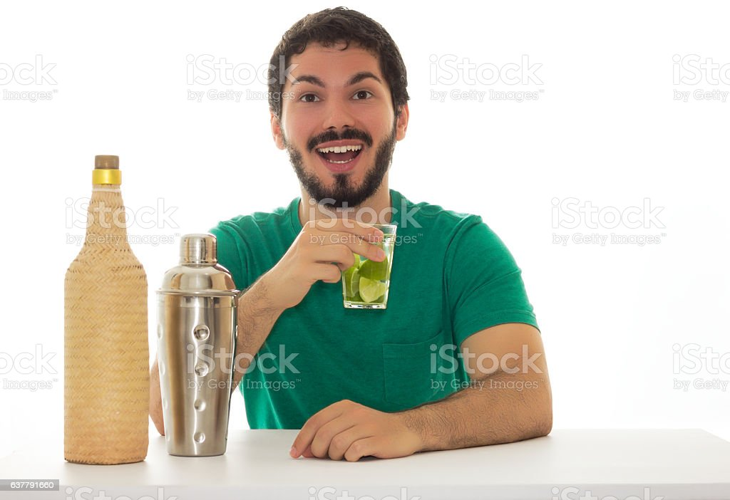 Person sitting at a table, drinking and having fun. stock photo