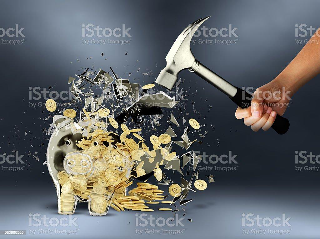person smashes a piggy-bank. stock photo