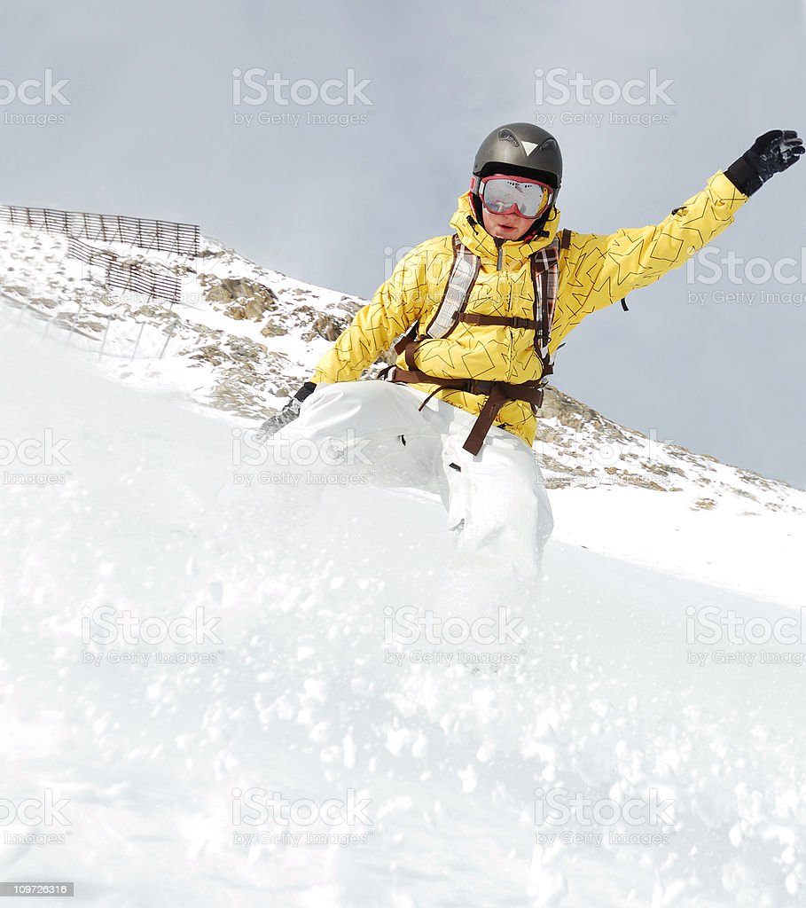 Person Snowboarding on Mountain in Fresh Powder royalty-free stock photo
