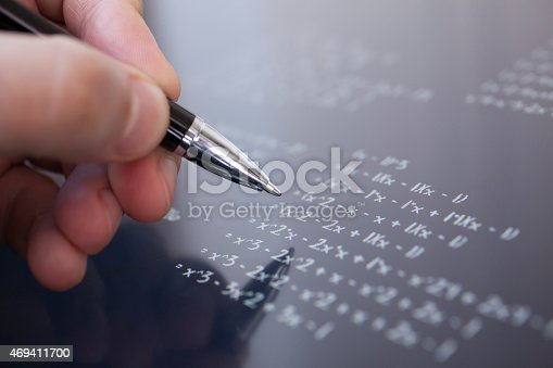 istock Person solving a math problem using a pen 469411700