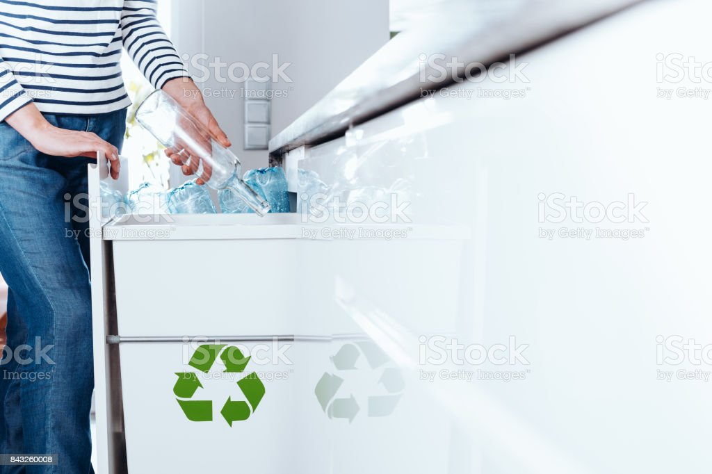 Person sorting glass bottles stock photo