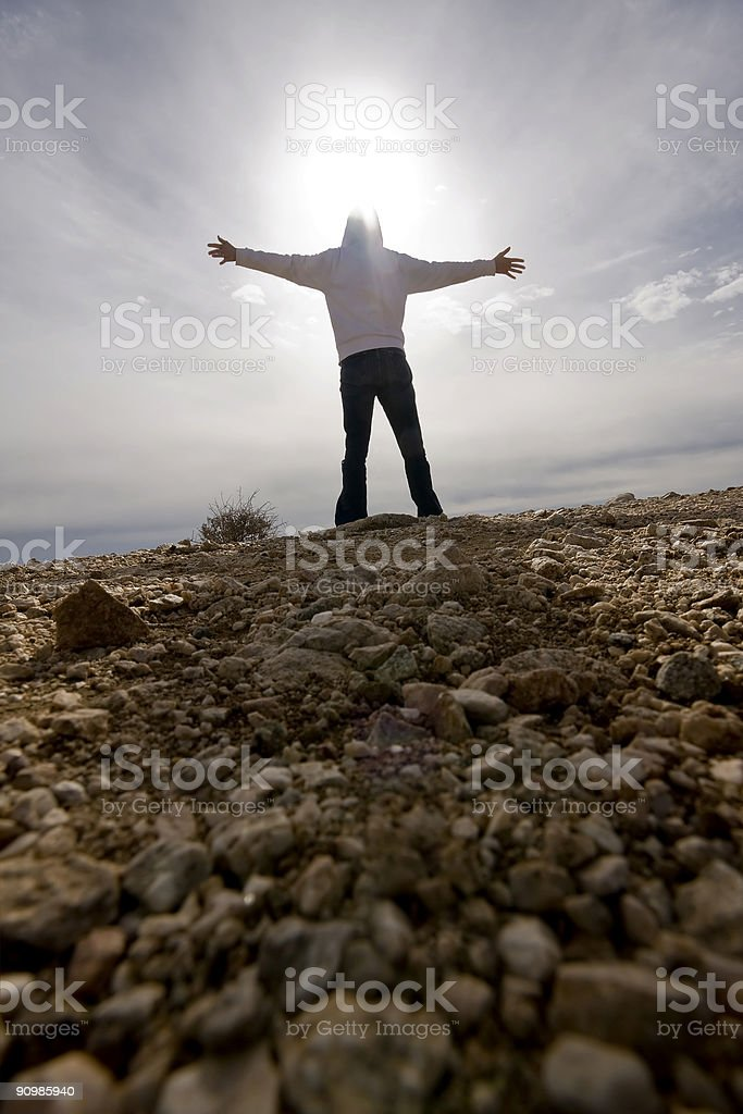 Person Standing Arms Outstretched stock photo