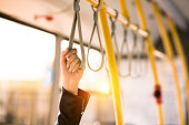 close-up partial view of person standing in city bus