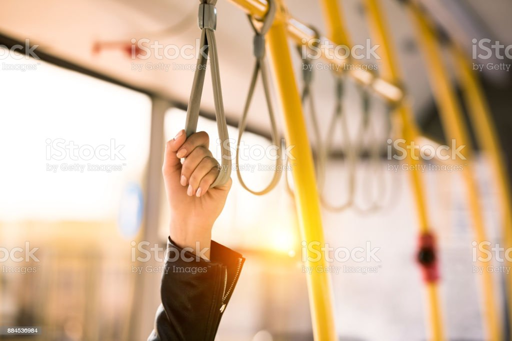 person standing in bus stock photo