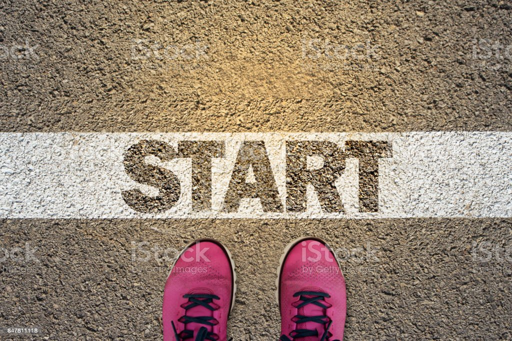 A person standing in the starting line stock photo