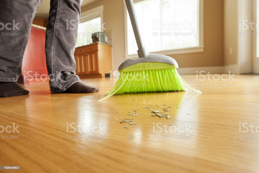 Person Sweeping Mess On Hardwood Floor With Broom Stock Photo More