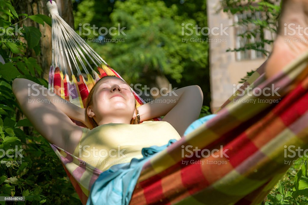 Person swinging in Hummock at Summer Garden stock photo