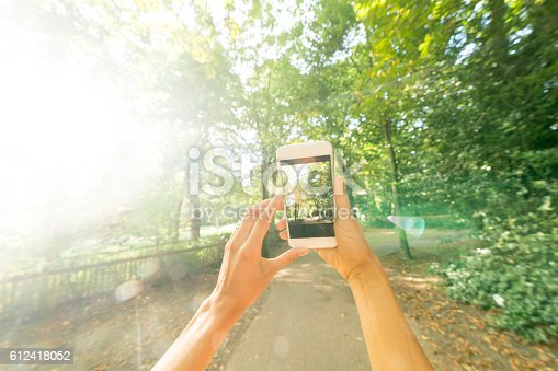 599114758 istock photo Person taking a picture at the park 612418052