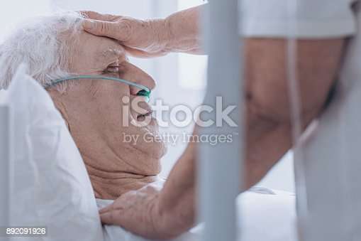 886711404istockphoto Person taking care of man 892091926