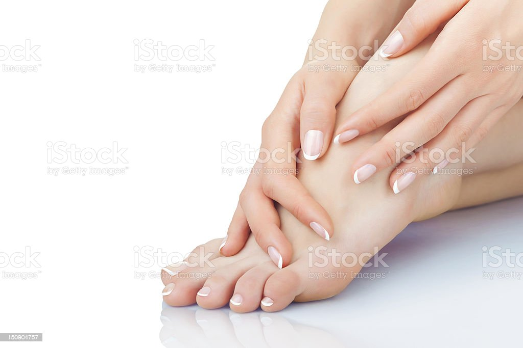 A person taking care of their feet stock photo