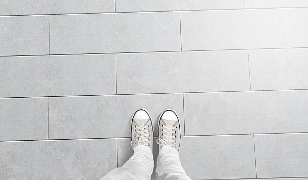 person taking photo of his foots stand on blank floor - 발 뉴스 사진 이미지