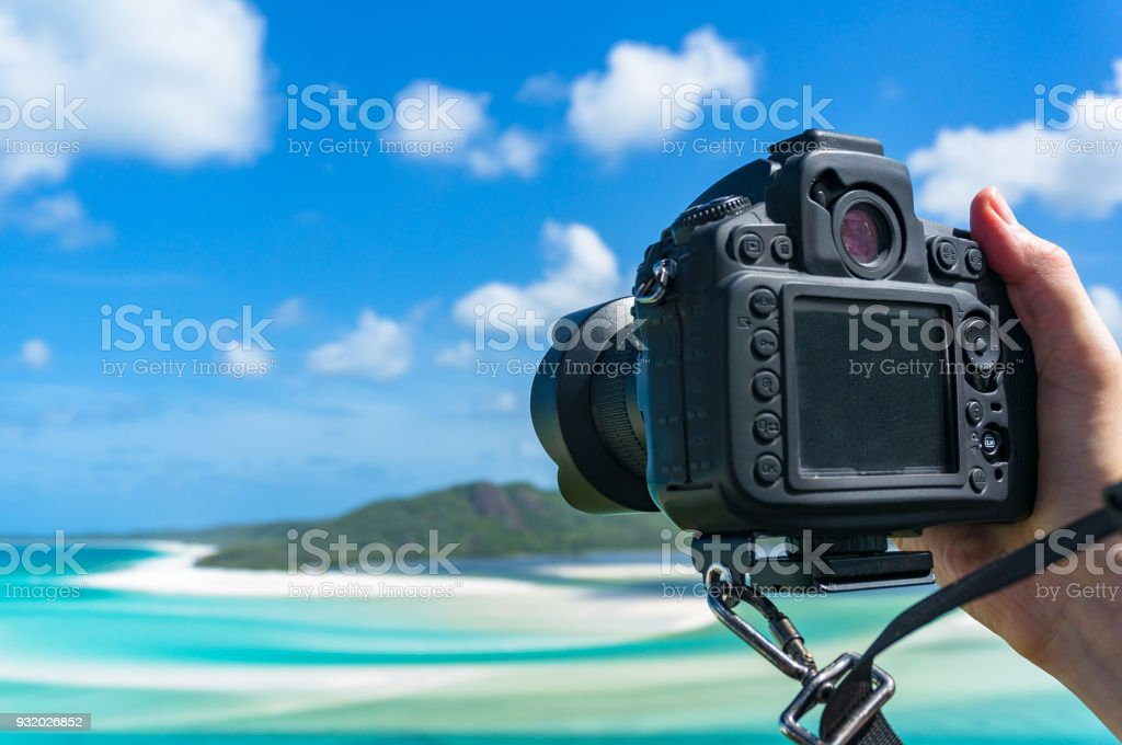 Person taking photo with DSLR camera stock photo