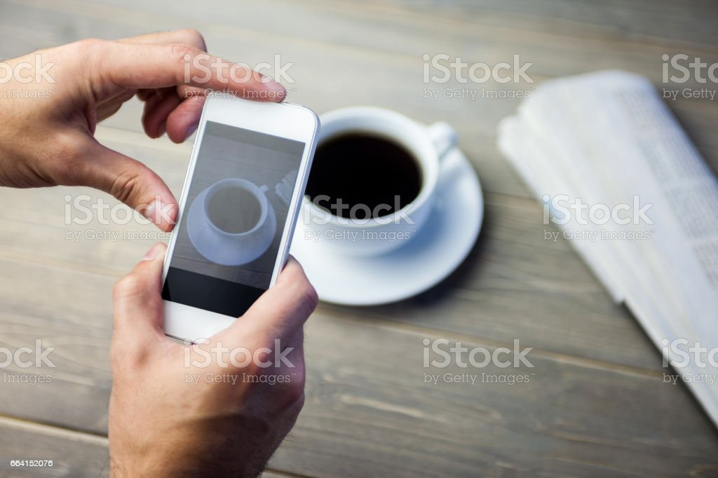Person taking picture through smartphone foto stock royalty-free