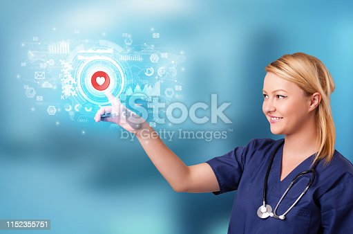 istock Person touching light blue hologram screen 1152355751
