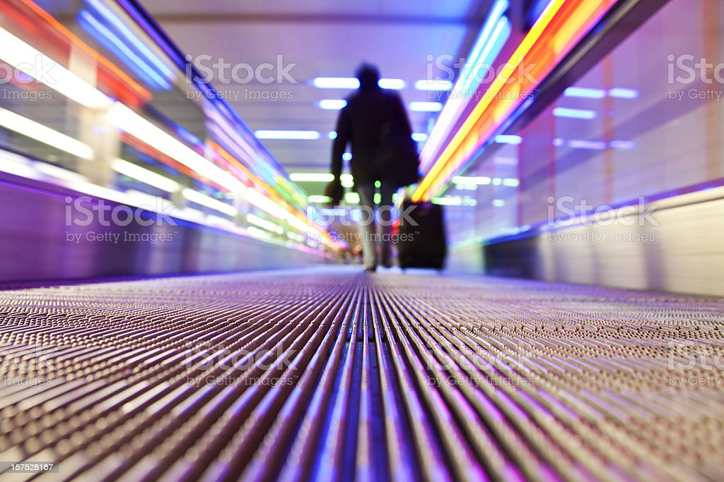 Person traveling on flat escalator stock photo