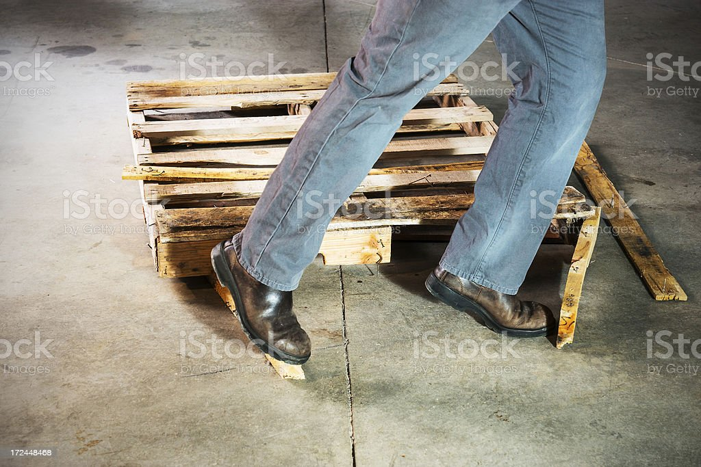 Person tripping over a warehouse hazard royalty-free stock photo