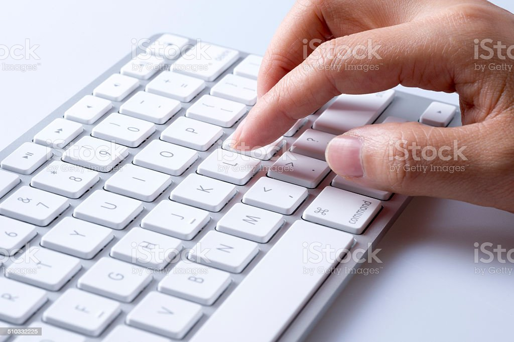 Person Typing on Keyboard stock photo