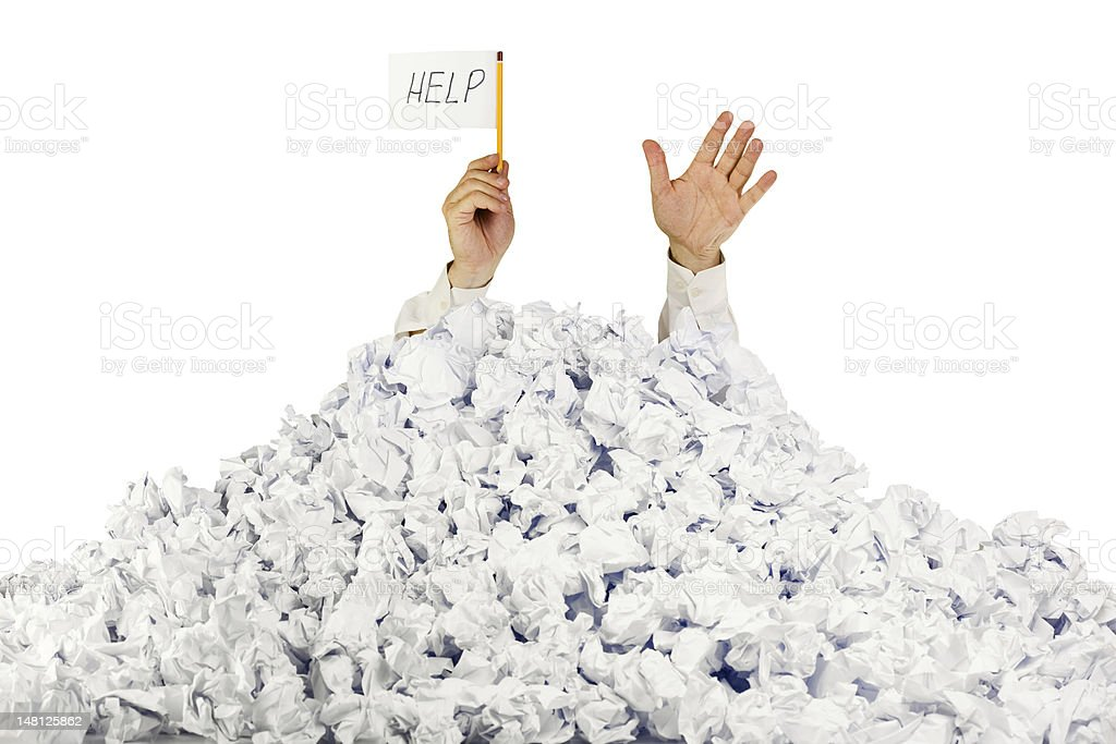 Person under crumpled pile of papers with  help sign royalty-free stock photo