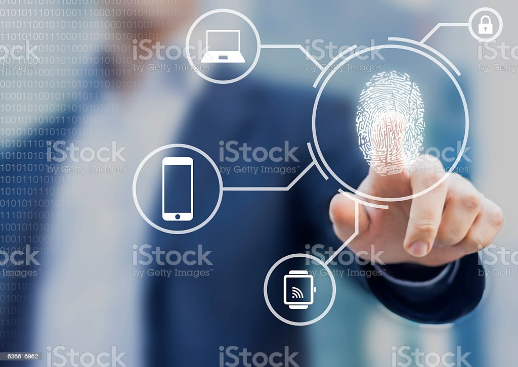 Person unlocking devices with fingerprint scan using biometrics stock photo