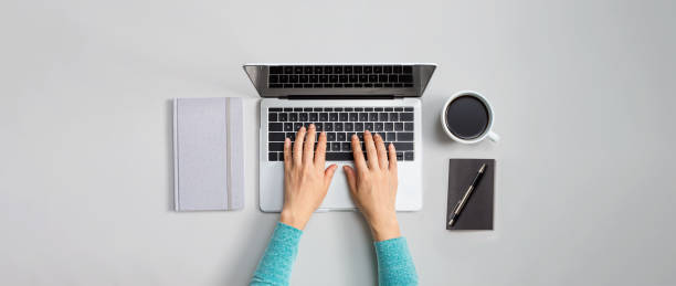 Person using a laptop computer stock photo