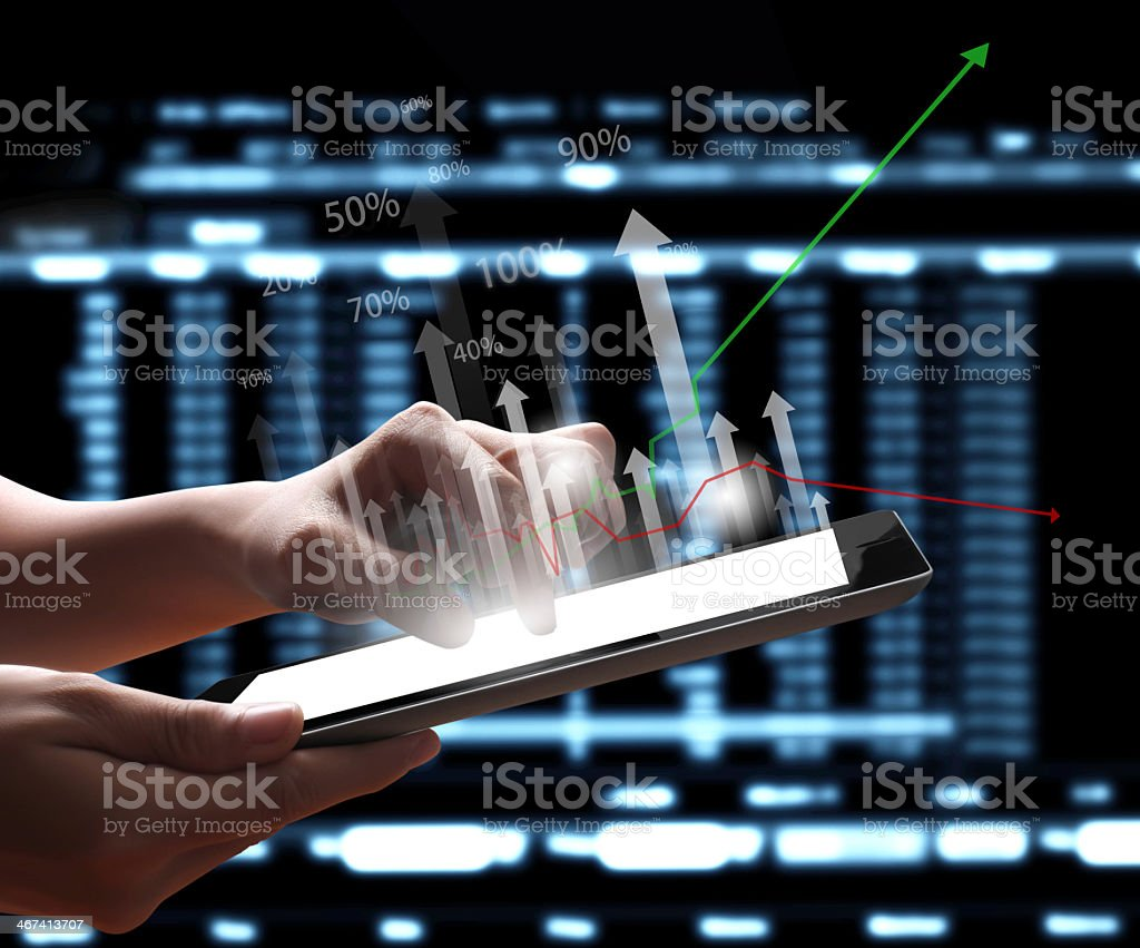 Person using a touchscreen tablet with arrows pointing out stock photo