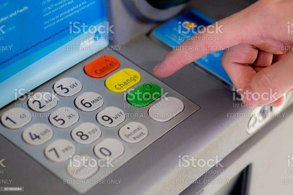 Person using an ANZ ATM stock photo