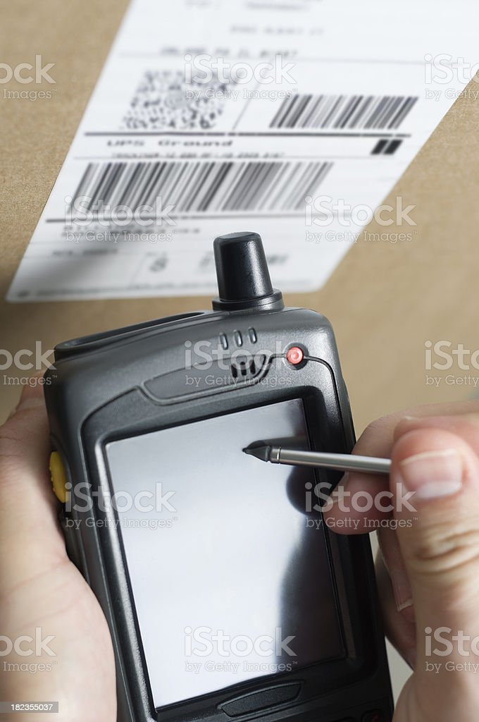 Person Using Barcode Scanner Taking Inventory royalty-free stock photo
