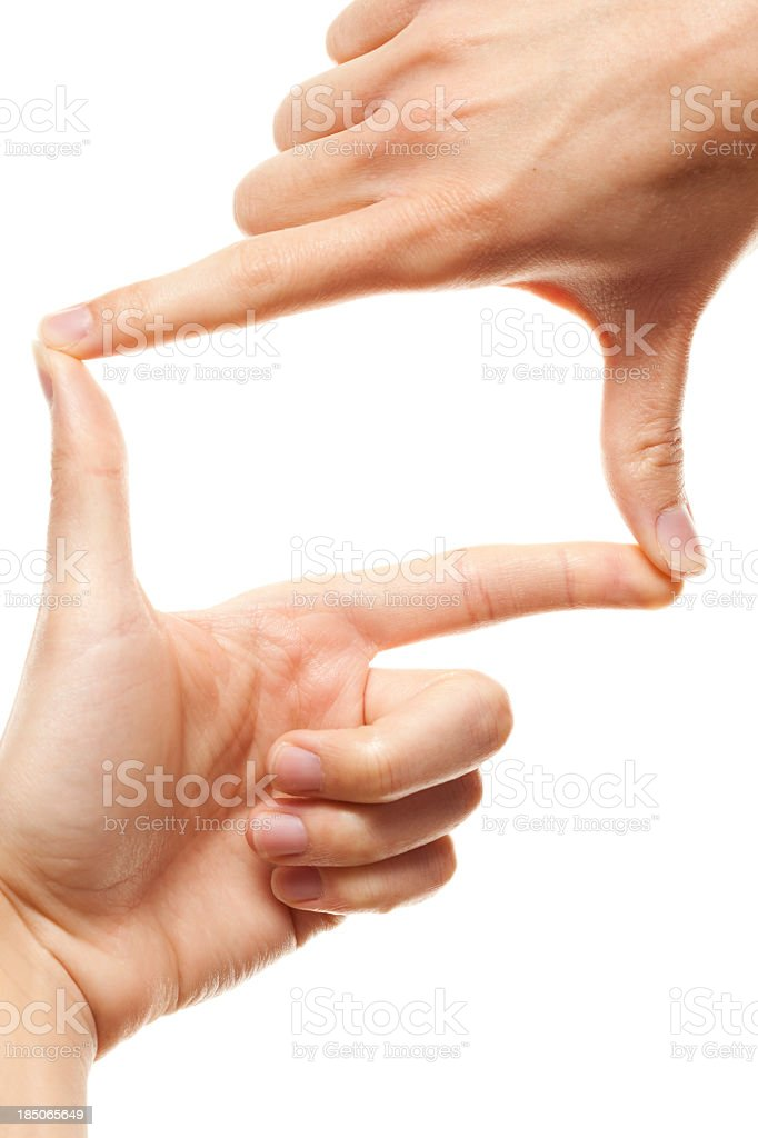 A person using both thumbs and index fingers to make a frame royalty-free stock photo