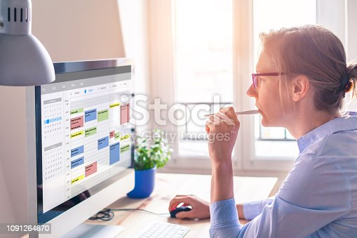 Person using calendar on computer to improve time management, plan appointments, events, tasks and meetings efficiently, improve productivity, organize week day and work hours, business woman, office