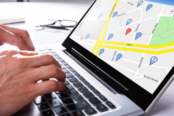 Person Using Gps Map On Laptop A Person Using Gps Map With Navigation Pointer On Laptop global positioning system stock pictures, royalty-free photos & images