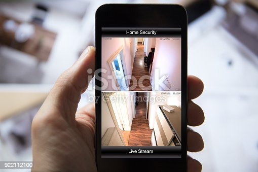 istock Person Using Home Security System On Mobile Phone 922112100