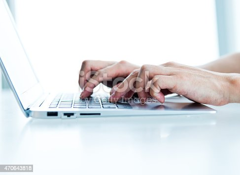 Close-up of man hands working on laptop.