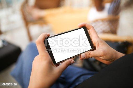 istock Person using mobile smartphone 598562436