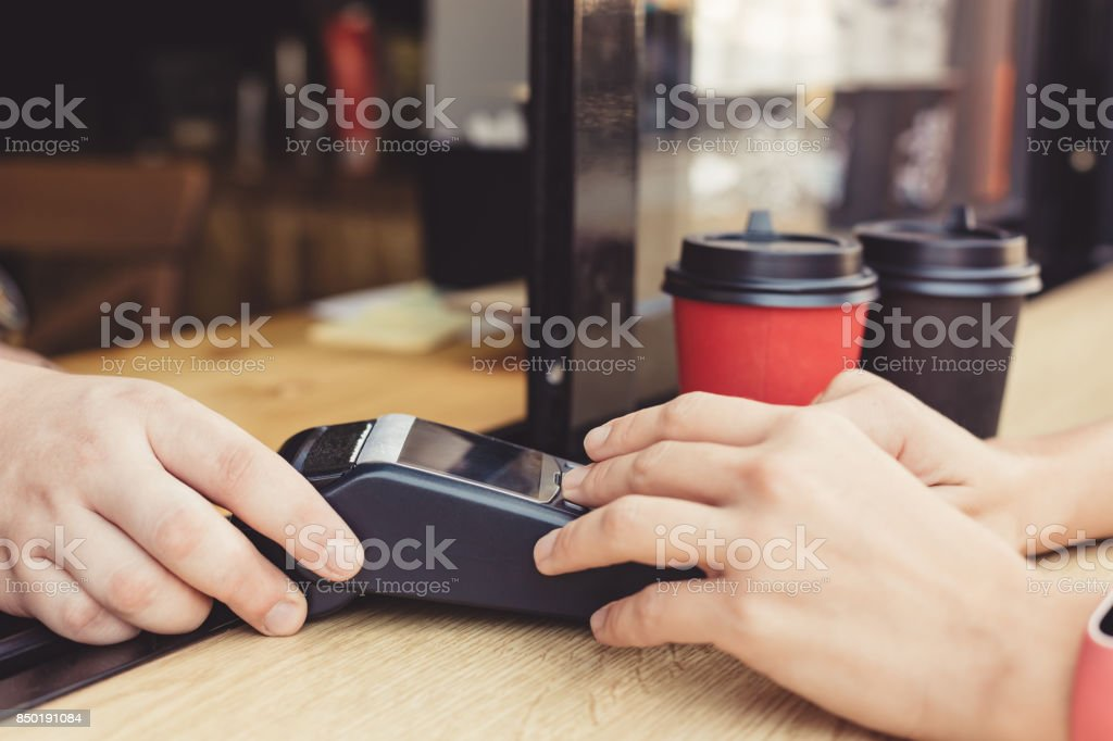 Person using pos terminal at the cafe stock photo