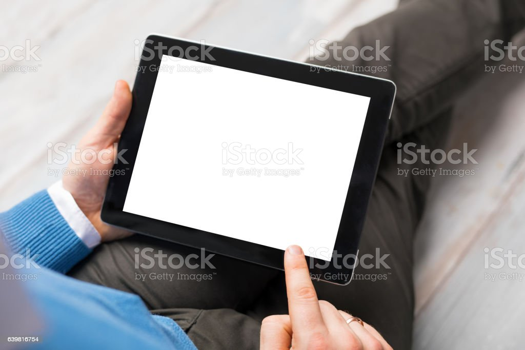 Person using tablet computer stock photo