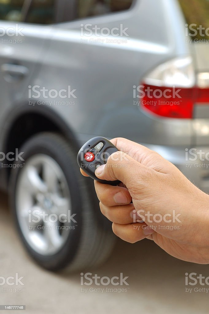 Person using the key fob on his car keys royalty-free stock photo