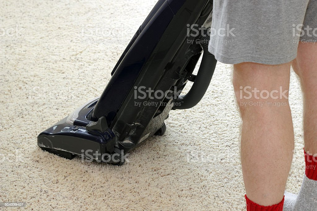 Person Vacuuming Carpet stock photo