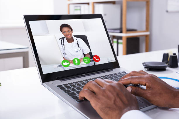 person video conferencing with female doctor through laptop - telemedicine stock pictures, royalty-free photos & images