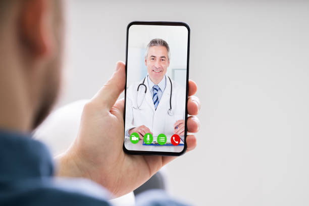 Person Videochatting With Doctor stock photo