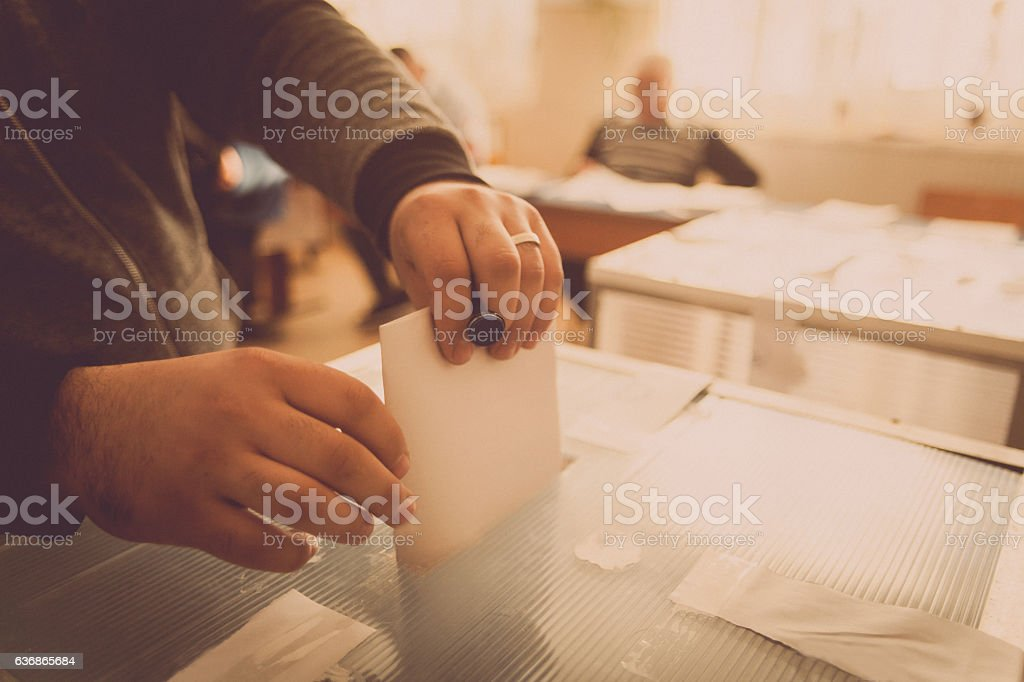 Person voting at polling station royalty-free stock photo