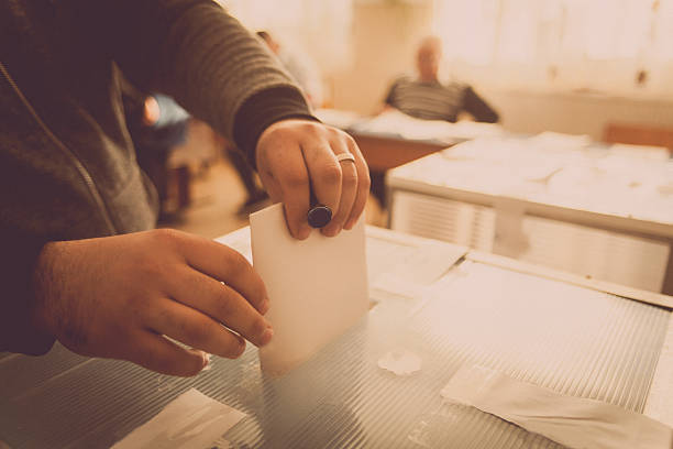 Person voting at polling station stock photo