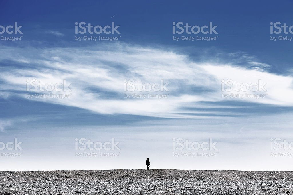 Person walk alone in a desert landscape stock photo