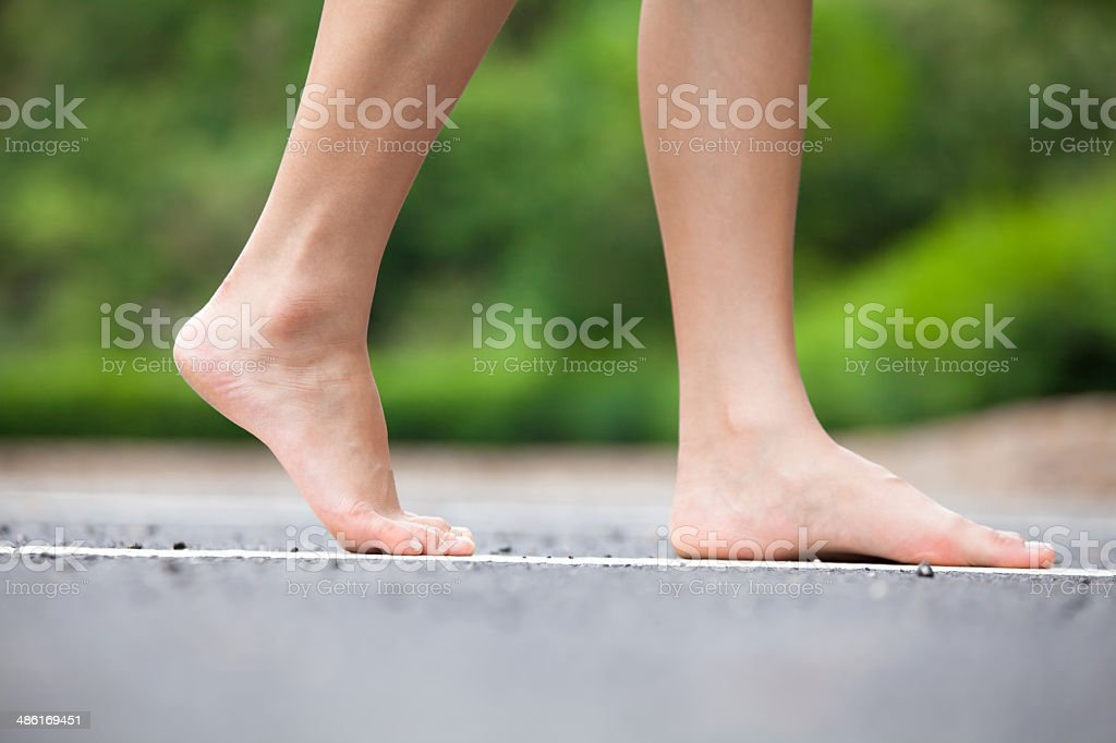 Person Walking on Street stock photo