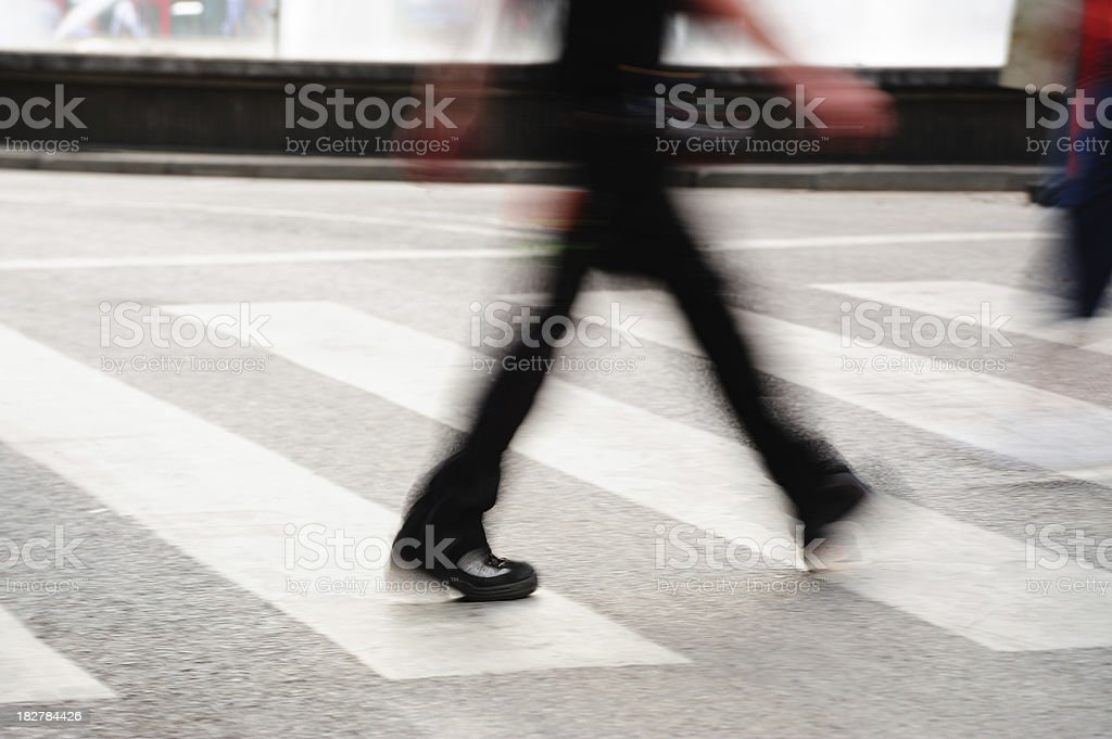 Person walking on zebra crossing royalty-free stock photo